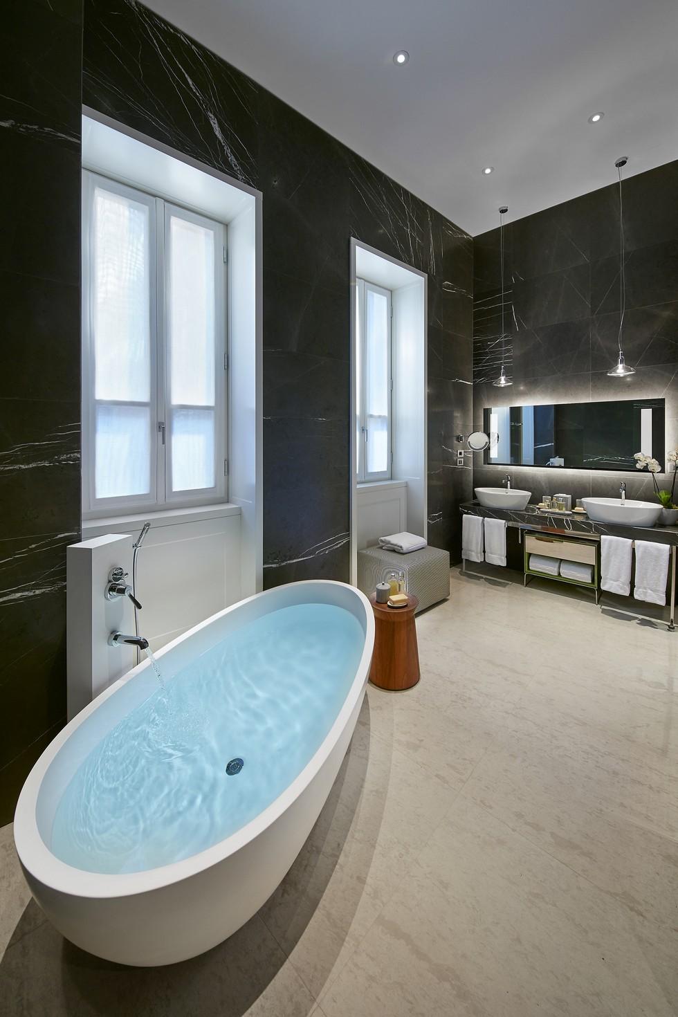 Milano suite bathroom by Piero Fornasetti